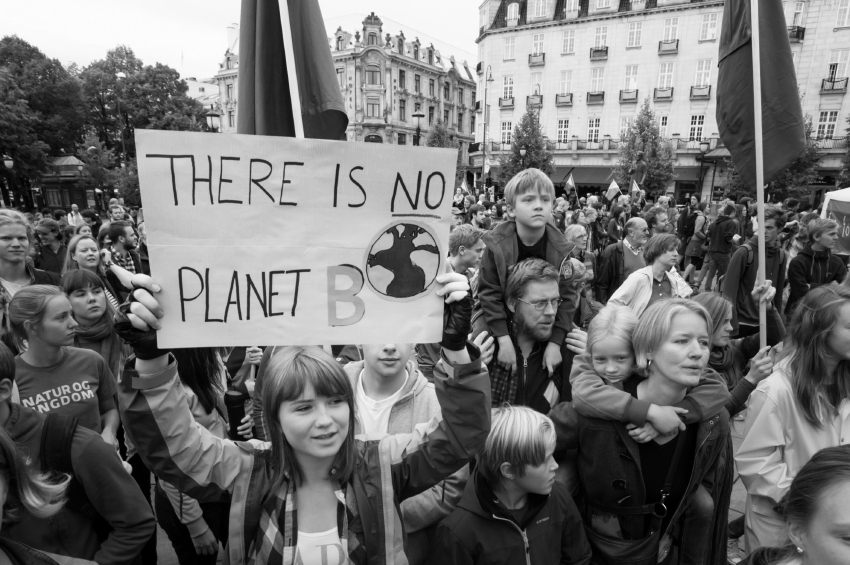 """A sign reads, """"There Is No Planet B"""", as parents carry children among thousands marching through central Oslo, Norway, to support action on global climate change, September 21, 2014. According to organizers of """"The People's Climate March"""", the Oslo demonstration was one of 2,808 solidarity events in 166 countries, which they claim was """"the largest climate march in history""""."""