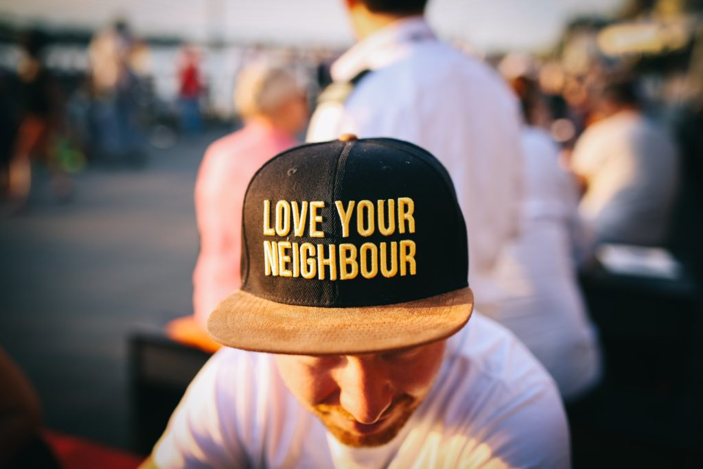 A baseball cap with Love Thy NEighbour written on it